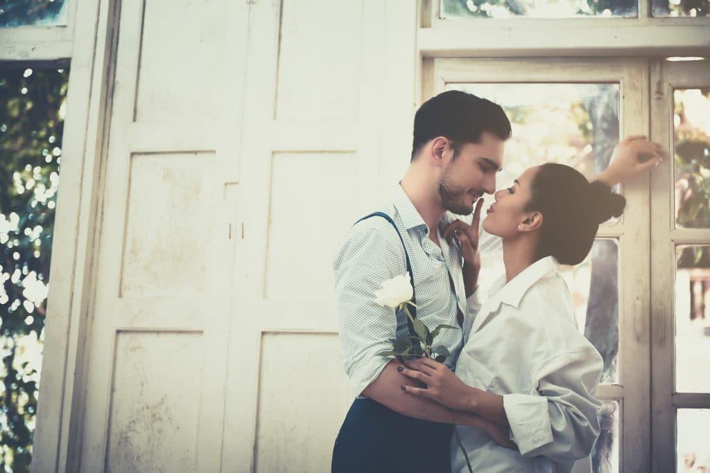 woman kiss man passion