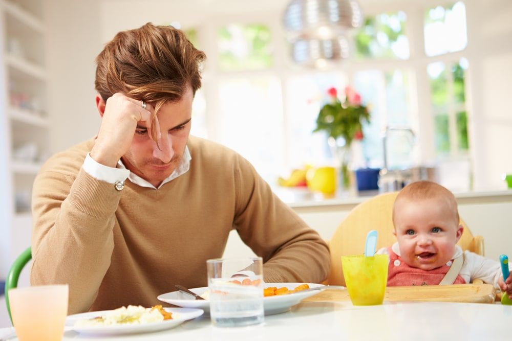 depressed father with baby
