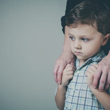 worried kid with mother
