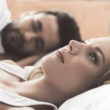 depressed woman with man in bed