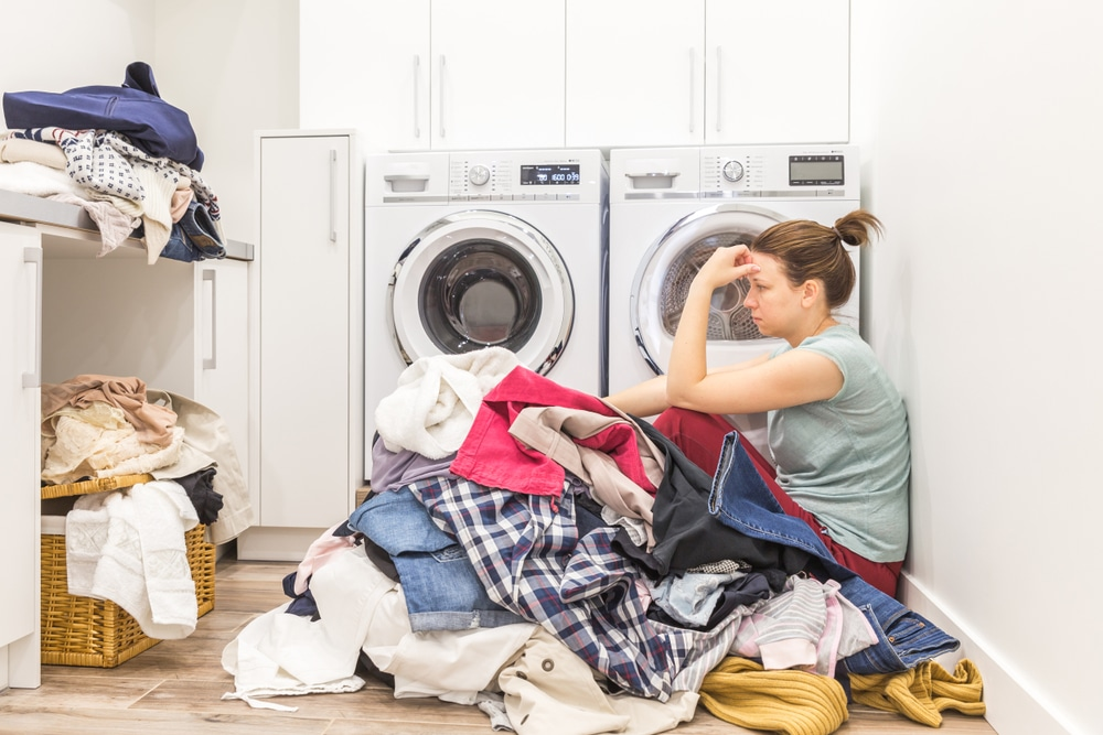 depressed mother doing laundry