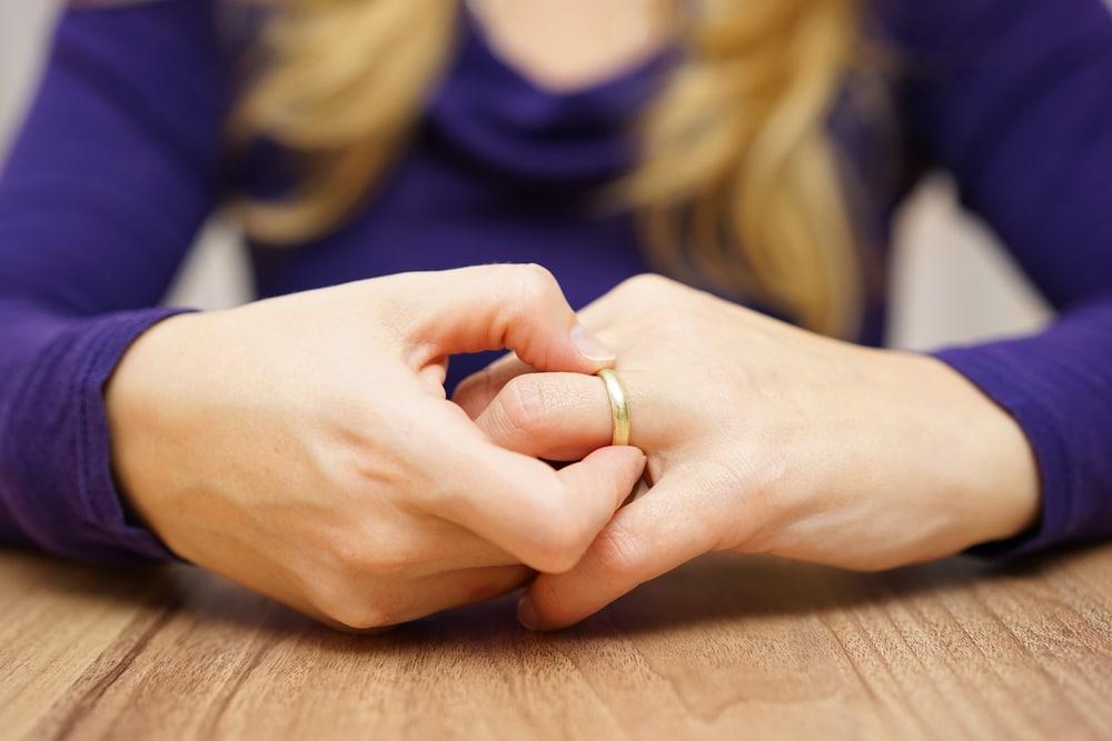 woman take off ring