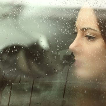 woman in car depressed