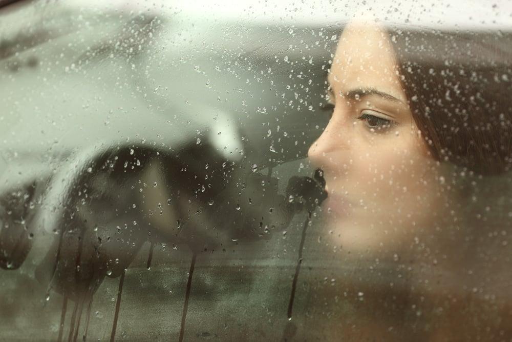 woman in car depressed