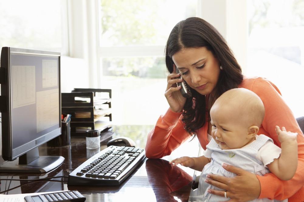 sad business mom with baby