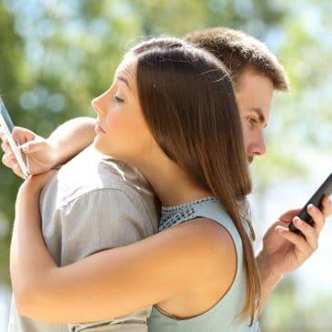 couple check cellphone