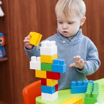 little kid play with blocks