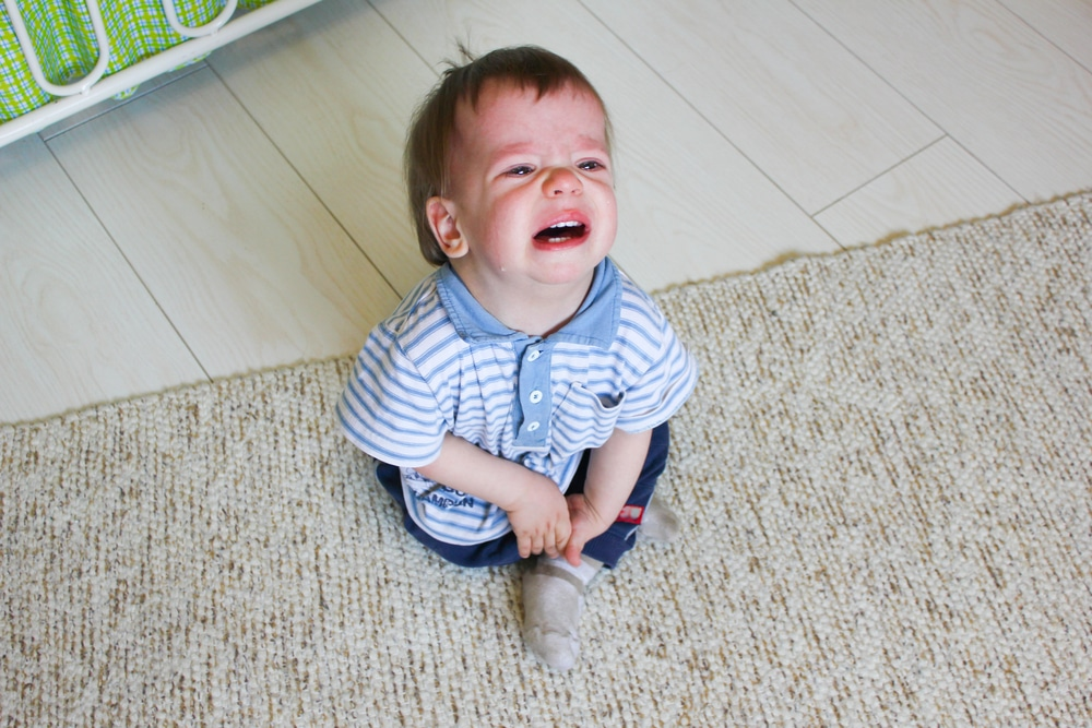 toddler crying on the floor