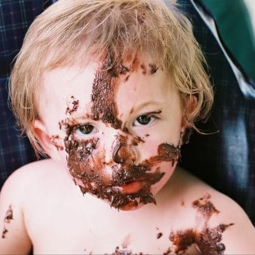 little boy with chocolate in his face