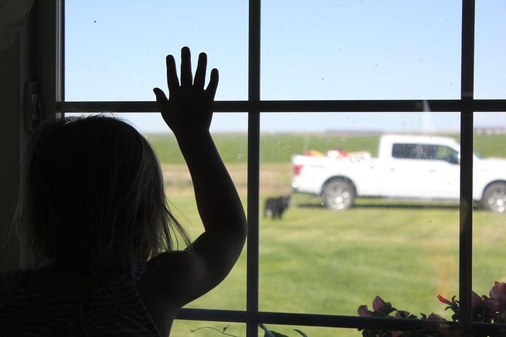 little girl say goodbye