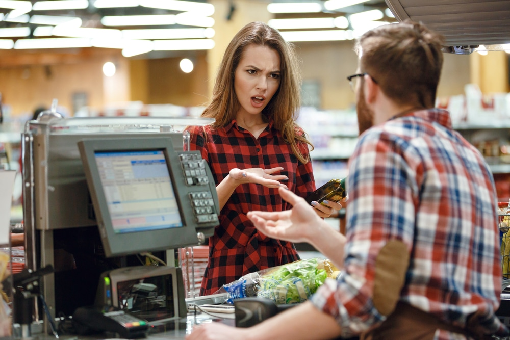 angry woman at cashier