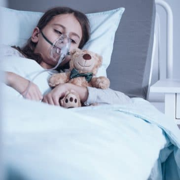 kid sick on hospital bed