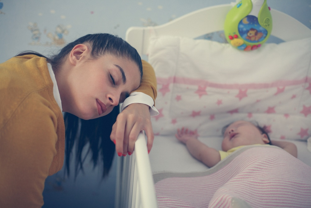 tired woman with baby