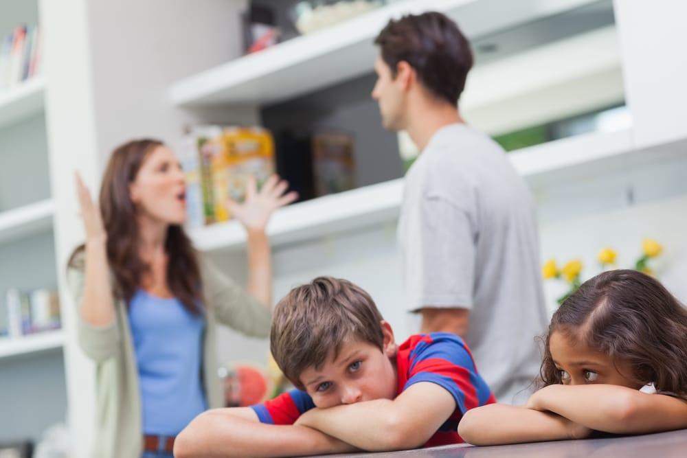father mother argue sad kids