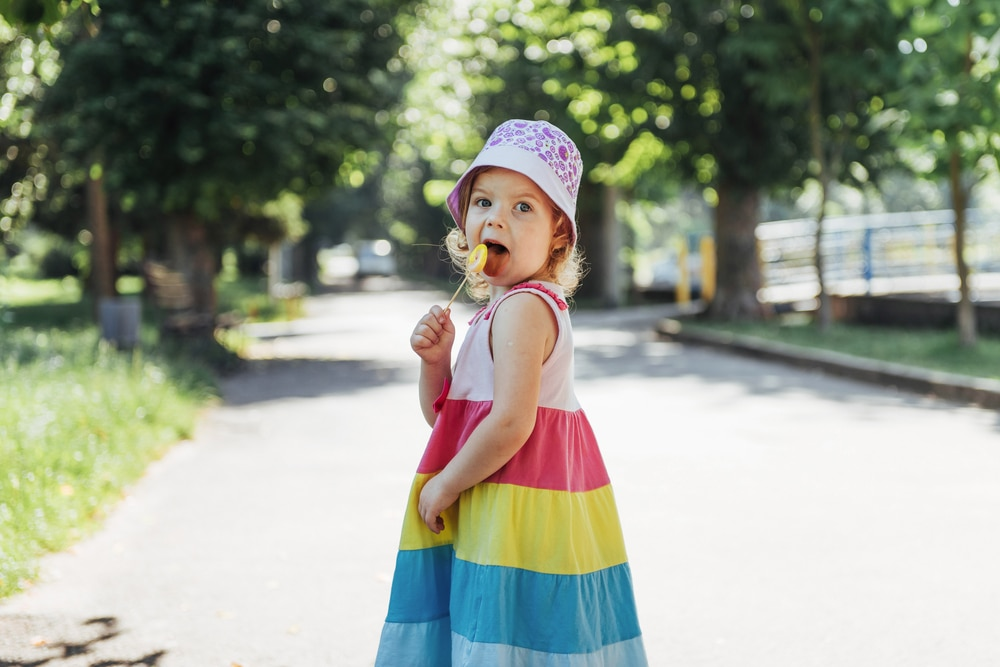 little girl with candy