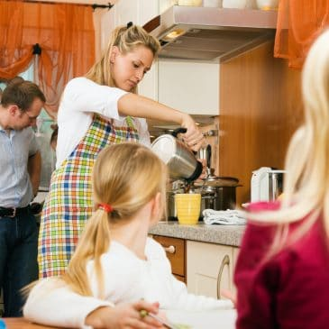 mother in kitchen with kids and husband