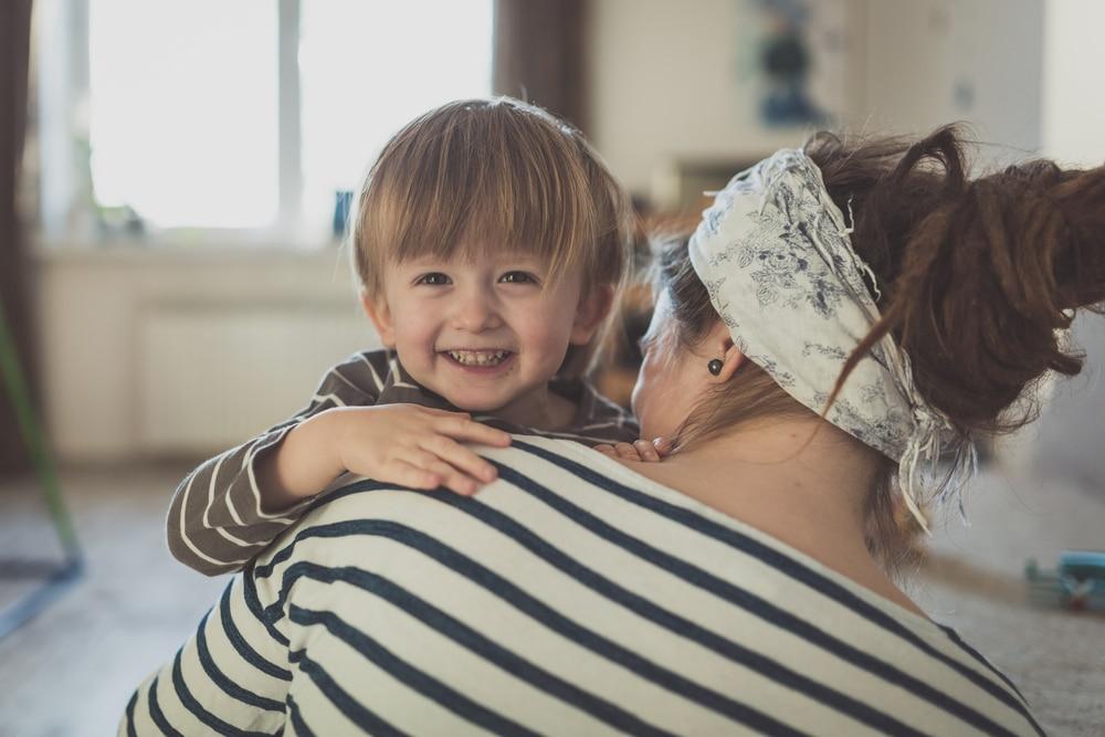 mother hug little boy