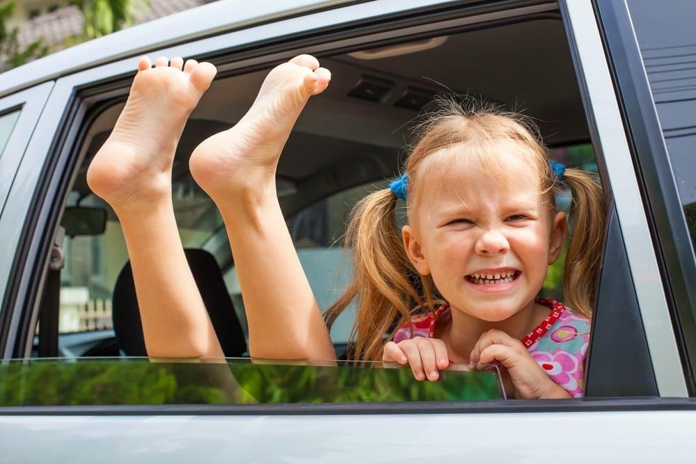 two happy kids in a car