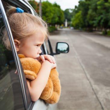 sad little girl in car