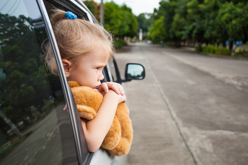sad little girl in car