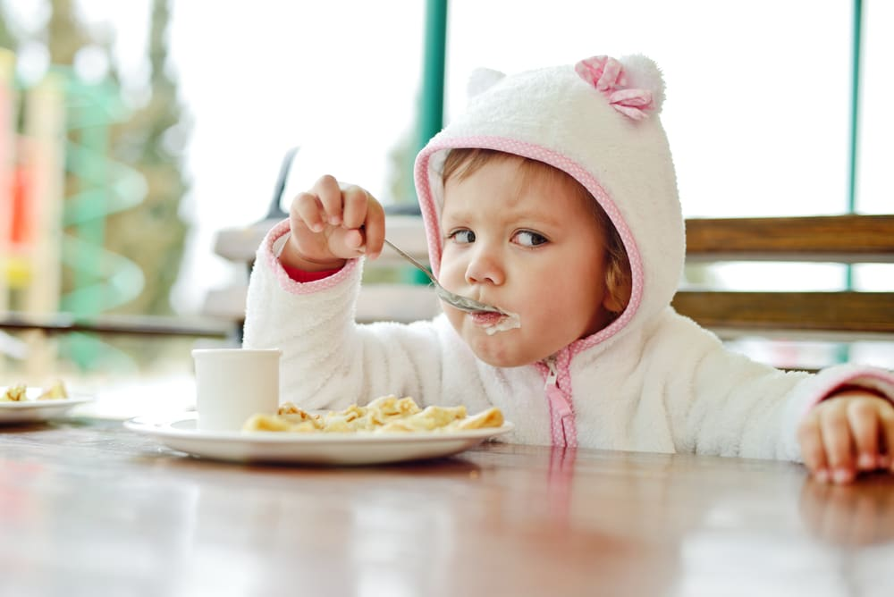 little girl eating restaurant