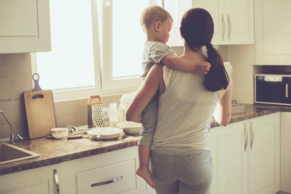 woman with toddler in kitchen