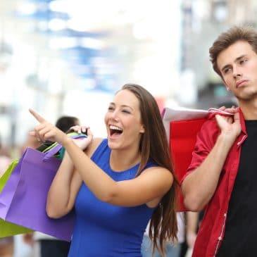 couple shopping unhappy man