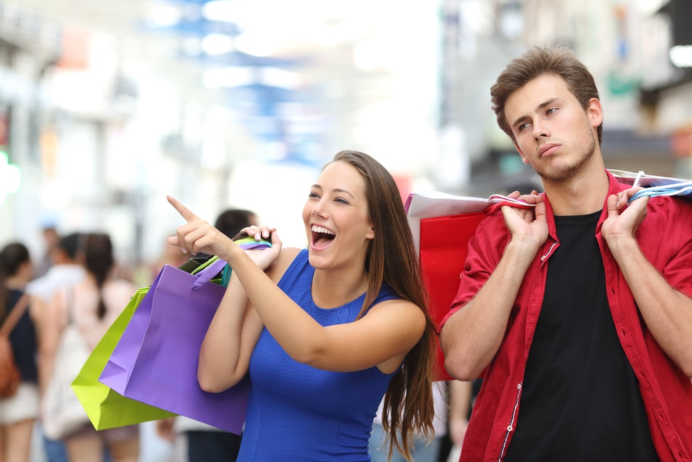 couple shopping unhappy man
