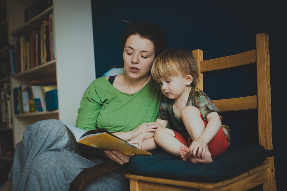 mother and kid reading a book