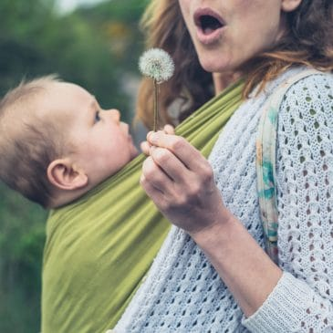 mother blow flower with baby