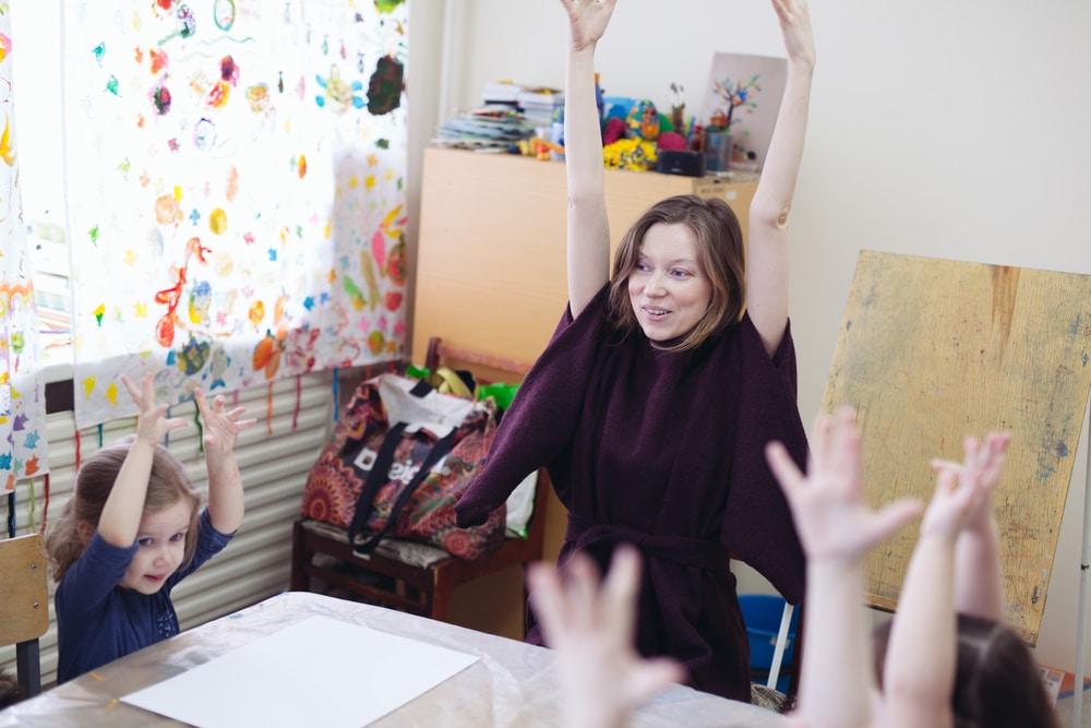 happy teacher and kids