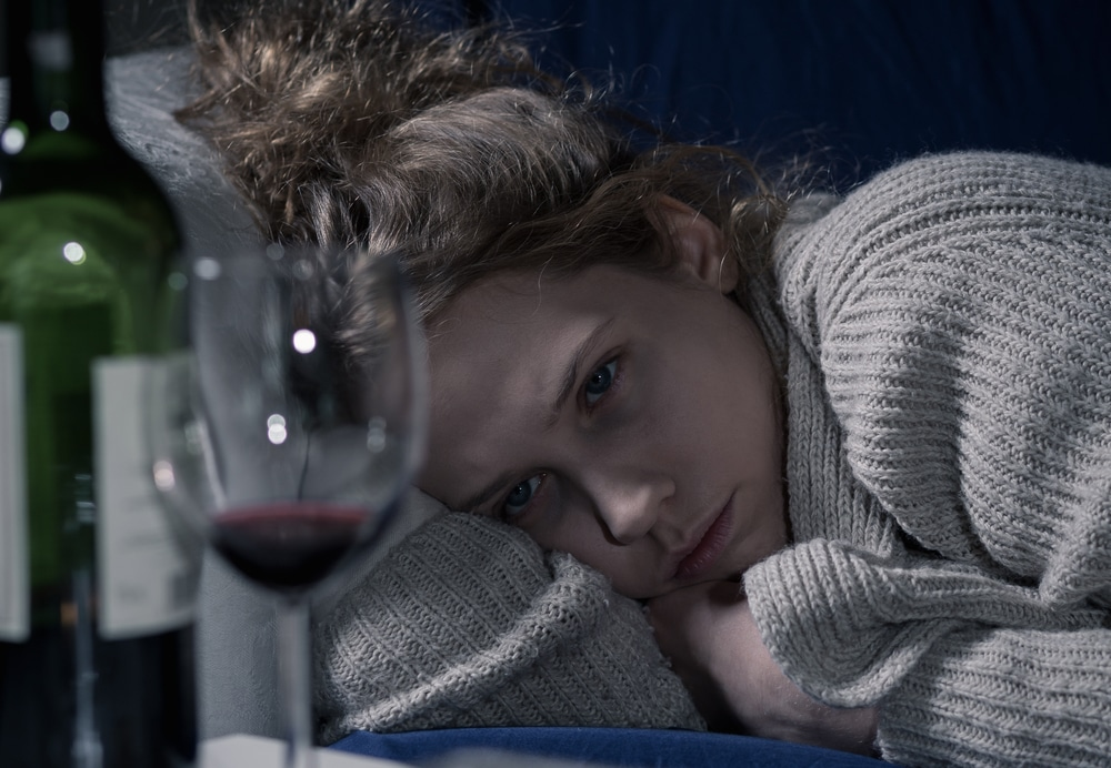 sad woman drinking wine
