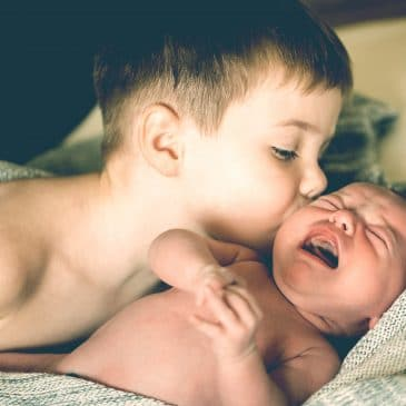 brother kiss newborn