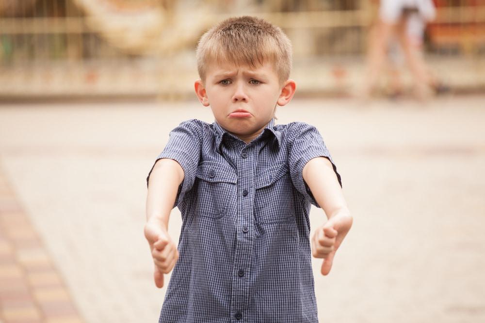 kid thumbs down