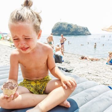 kid at beach crying