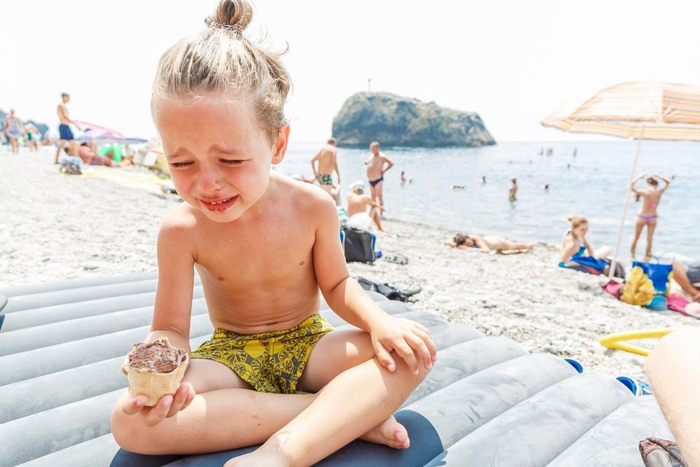kid at beach crying