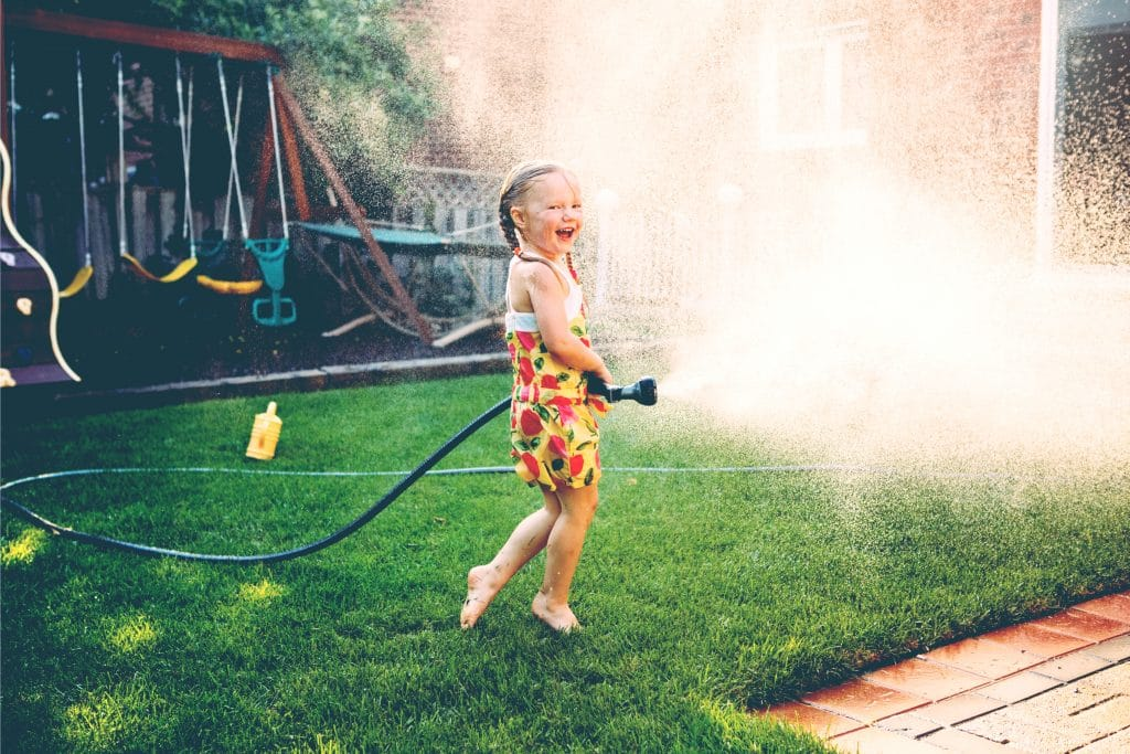 little girl play with hose