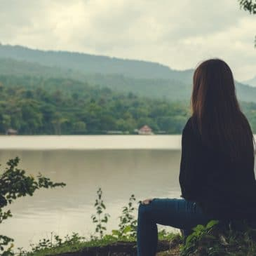 woman alone lake