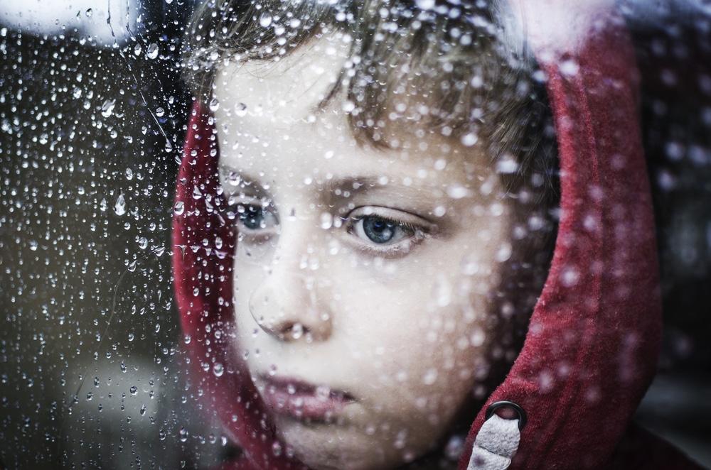 little boy looking in window