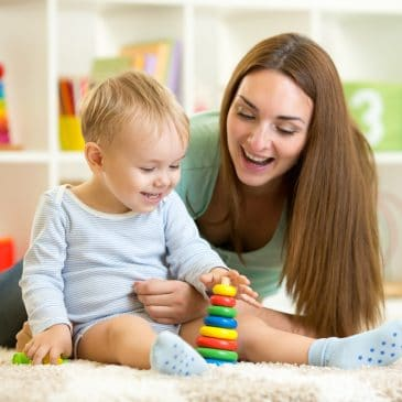 baby learning with mother