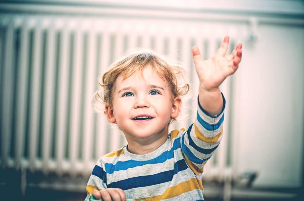 little boy waving