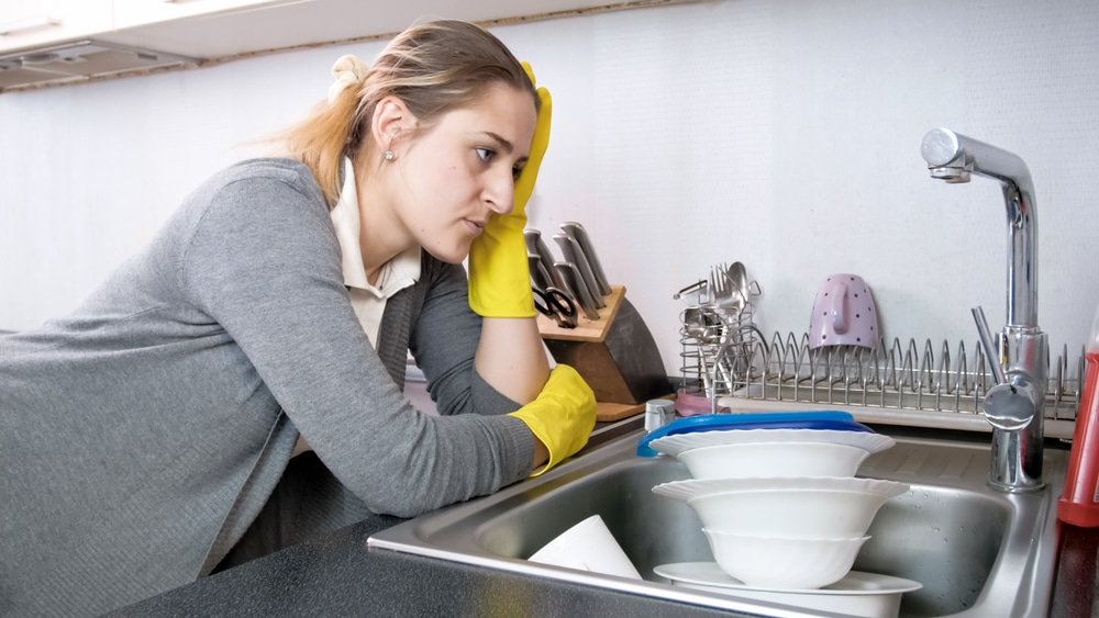 tired housewife dishes