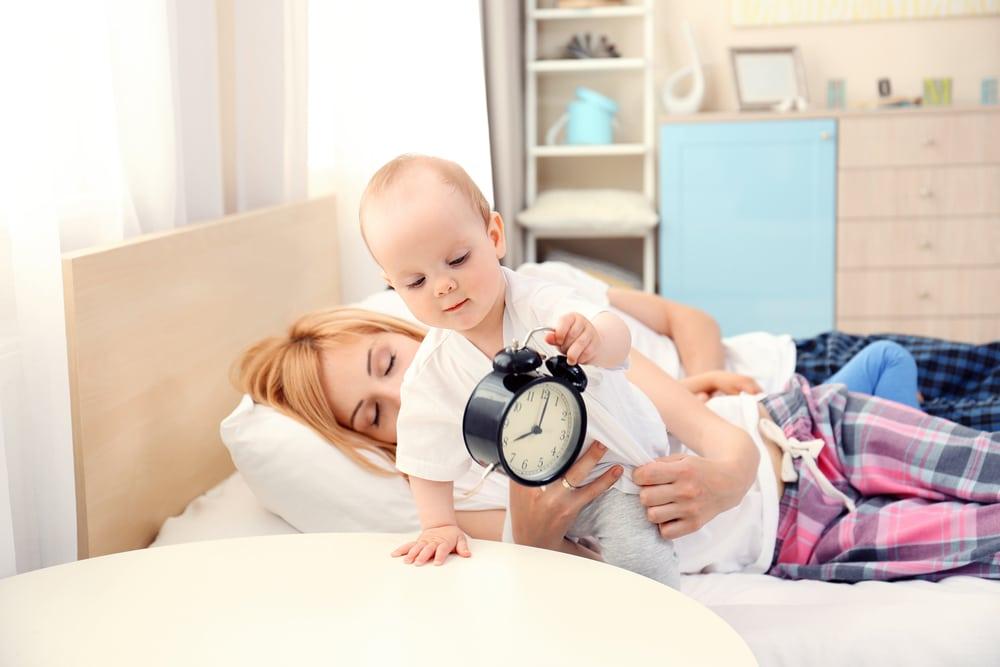 mother sleeping baby awake