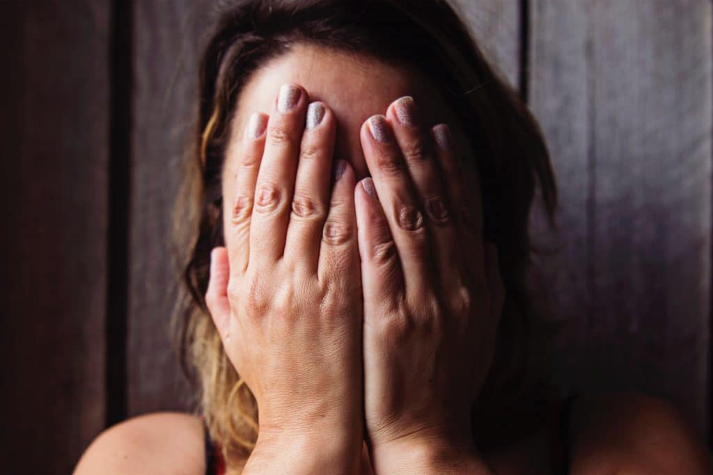 woman cry with face in hands