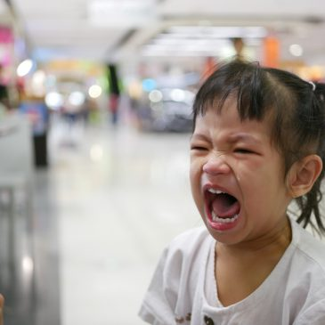 angry little girl at shopping center