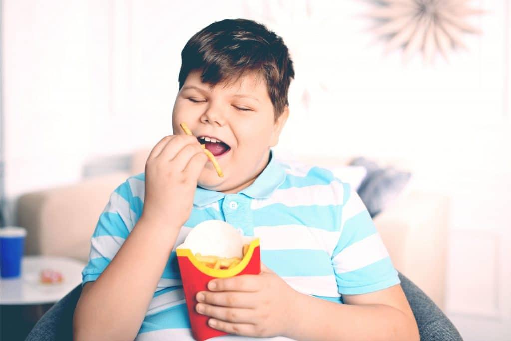 little boy eat fries