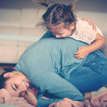 kid hug mother in living room