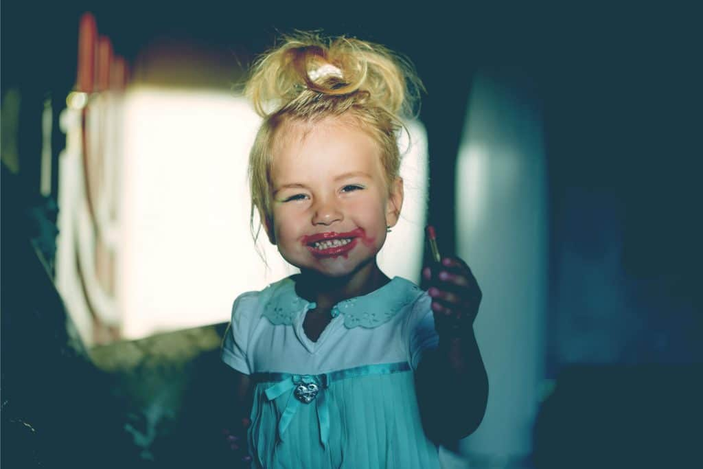 little girl with make up smile