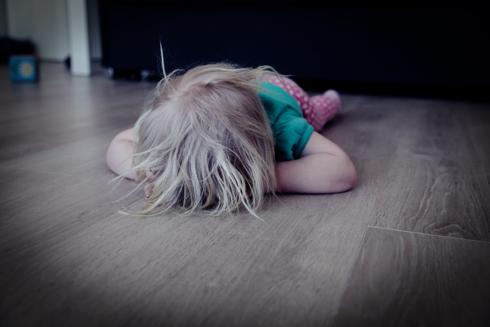 toddler cry on the floor