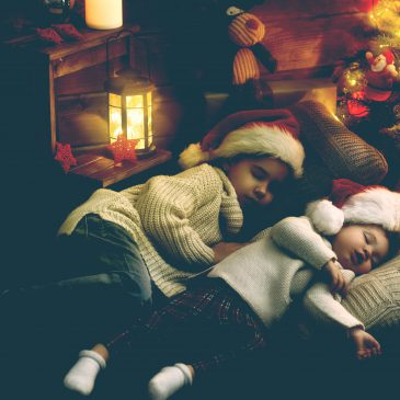 two little girls sleeping xmas tree